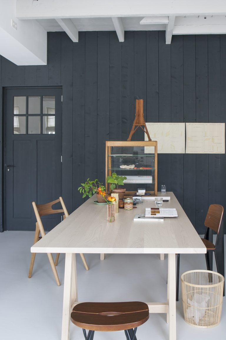 Christien Starkenburg, a furniture designer in the Netherlands, uses vertical wood paneling to emphasize the height of her small kitchen and dining area. Photograph courtesy ofAnna de Leeuwfrom our post Kitchen of the Week: The Curtained Kitchen, Dutch Modern Edition.