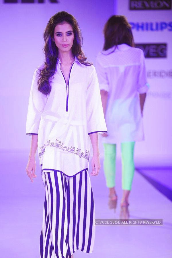 A model showcases a creation during Jabong Online Fashion Week, held at Hotel Le Meridian, in Delhi, on July 30, 2014.