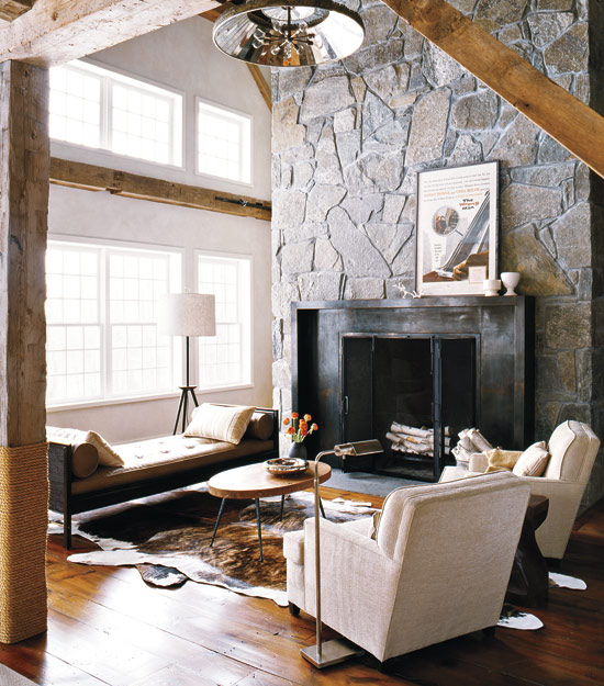The Addition Of A Cow Hide Area Rug Heightens Warmth And Beauty In Rustic Living E
