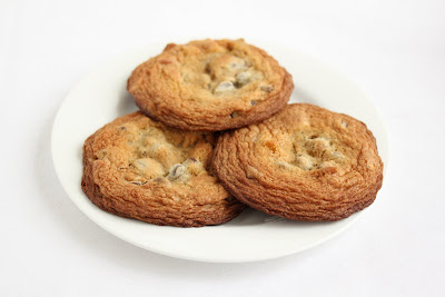photo of a three compost cookies on a plate