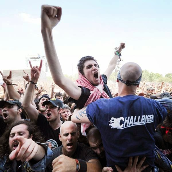 Heavy metal fans gesture during the Hellfest Heavy Music Festival on June 20, 2014 in Clisson, western France.