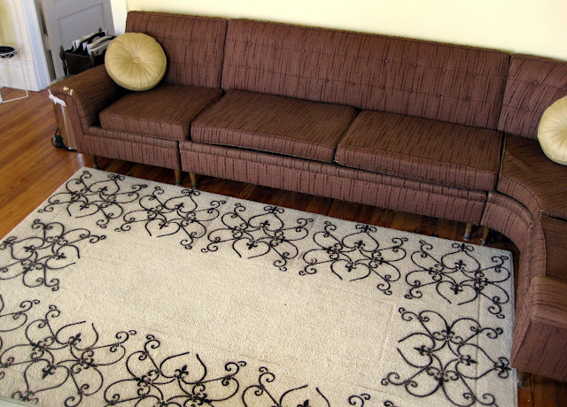 This once boring, drab rug now looks SO much nicer with the DIY stencil pattern along the border.