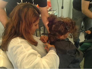 Mum and toddler having first haircut