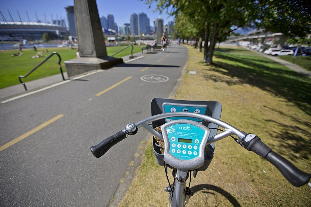 Over the handlebars of a mobi bike share bike in vancouver, BC