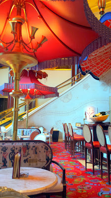 Relaxing in the Parasol Down bar and lounge (Parasol Up is on the same level before you go down the curved escalator) inside The Wynn. This is where after dusk you can also sit and see the various Lake of Dreams shows every 30 min
