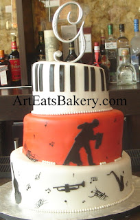 Three tier jazz and ballroom dancing white, black and blood orange birthday cake with piano keys, instruments, music notes and dancers