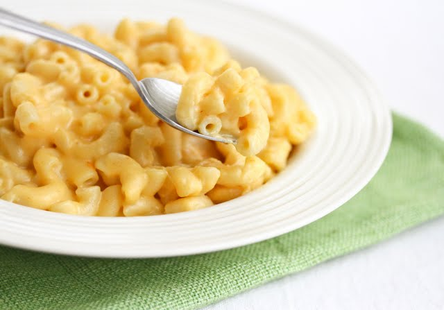 close-up photo of a bowl and spoonful of macaroni and cheese