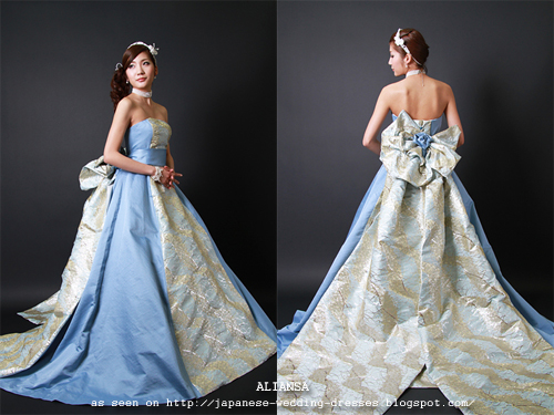 Strapless Light Blue Gown With Kimono Fabric Accents That Gathers In A Bow At The Back