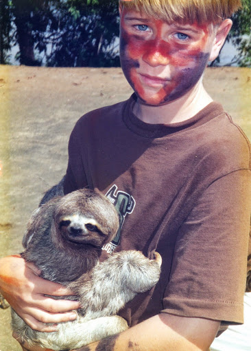 What do you do if you are a 3rd grader who desperately wants to visit a rainforest?  Jay Blaine with sloth, as a middle schooler