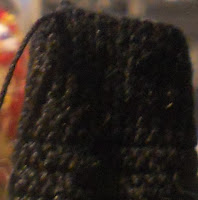 Close up view of the knitting, tightly crocheted