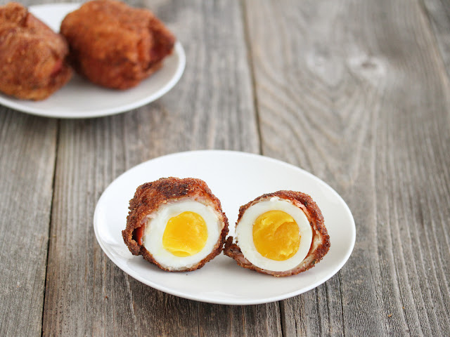 photo of one Fried Bacon Wrapped Egg on a plate
