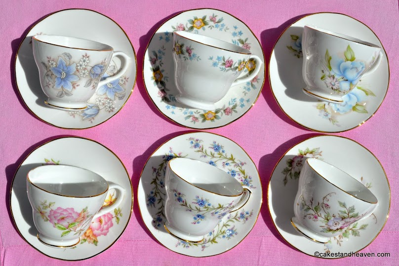 six mismatched soft pastel vintage teacups and saucers