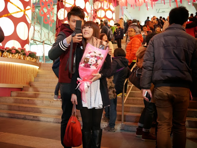 young couple taking a Valentine's Day selfie