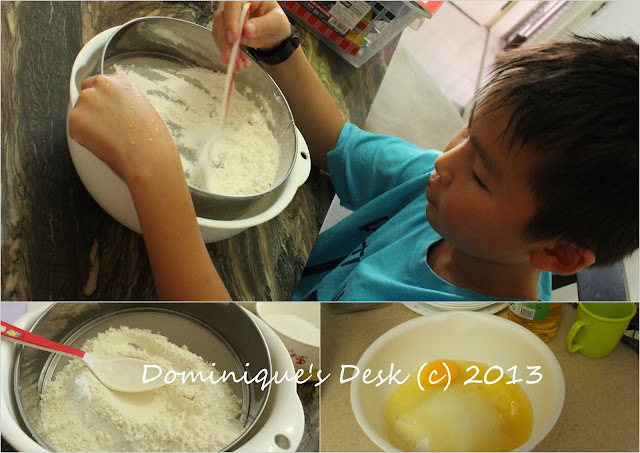 Monkey boy sieving the flour and mixing in the ingredients