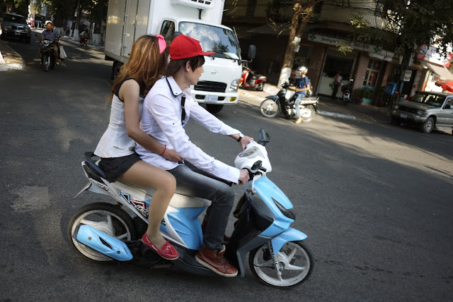 young fashionable couple on a motorbike