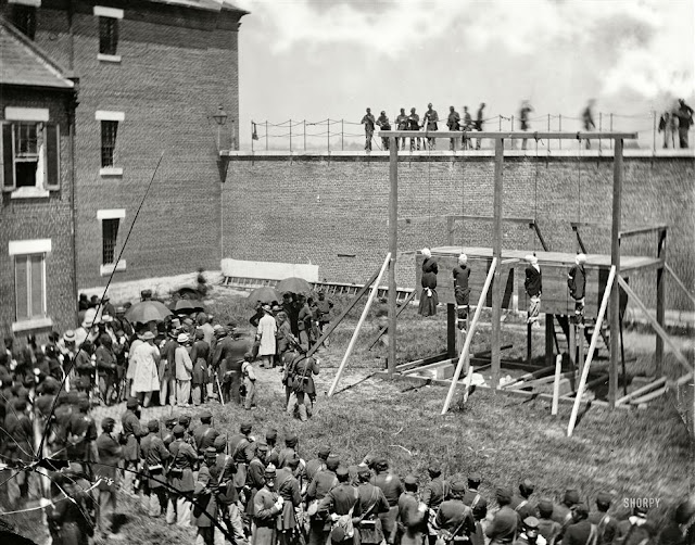 The execution of Lewis Powell, Mary Surratt, David Herold, and George Atzerodt.