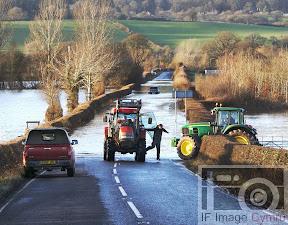 Farmers rescue flood motorist