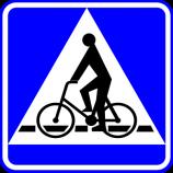 D-6a  przejazd dla rowerzystów  Oznacza miejsce przeznaczone do przejazdu dla rowerzystów w poprzek drogi. Znak umieszcza się bezpośrednio przed przejazdem dla rowerzystów oznaczonym znakiem poziomym P-11. Kierujący pojazdem zbliżający się do miejsca oznaczonego znakiem jest obowiązany zmniejszyć prędkość tak, aby nie narazić na niebezpieczeństwo rowerzystów znajdujących się w tych miejscach lub na nie wjeżdżających.