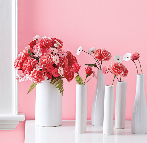 The bouquet makes a pretty centerpiece. Small vases with a few blooms are easy party favors.