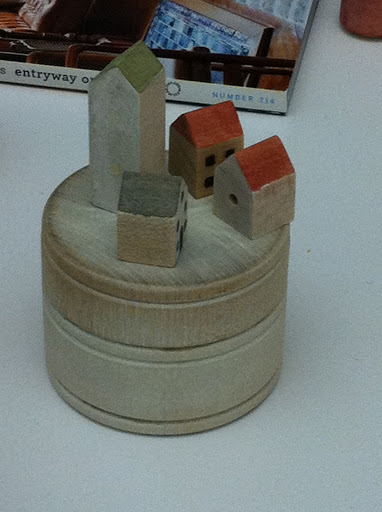 Miniature birdhouses being painted.