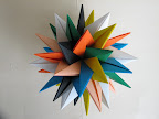 Seven Intersecting Stars by Meenakshi Mukerji at http://www.davidpetty.me.uk/origamiemporium/images/mm_tuvwxyz.gif