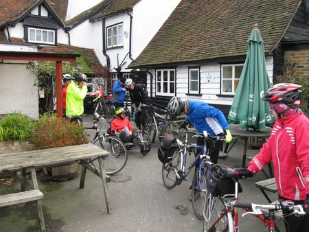 Cyclists outside pub