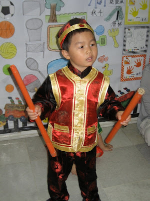Monkey boy in Chinese costume while at pre-school