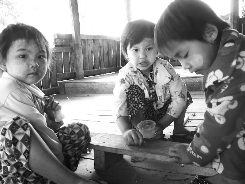 Kids playing with razor blades at the rotating market at Inle Lake