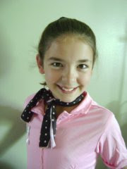 The Sock Hop Sally has a pink polyester top accented by a black with pink polka-dot scarf