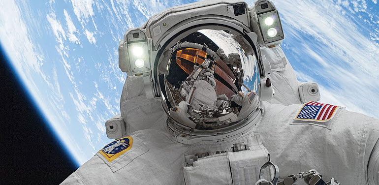 Astronaut spacewalk over Earth