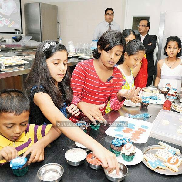 Children at the baking demonstartion at Ecole Hoteliere celebrating the rains at Lavasa.