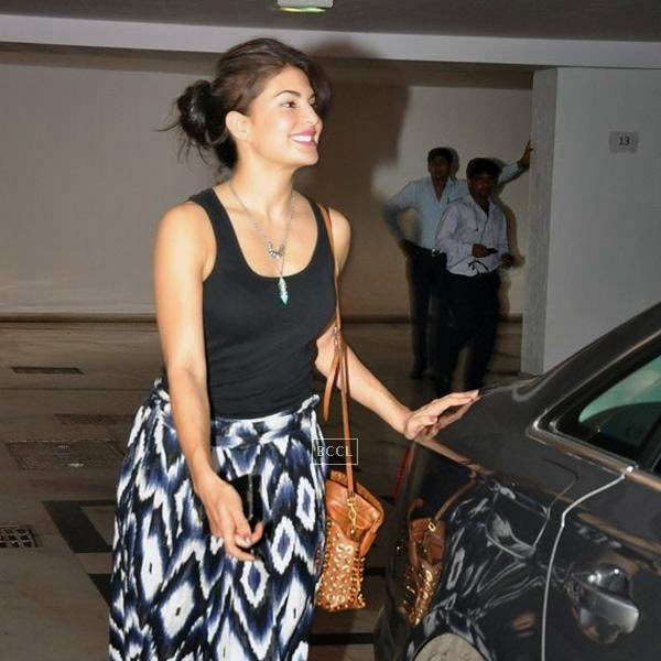 Jacqueline Fernandez leaves after attending Karan Johar's party, organised at his residence, on July 26, 2014.(Pic: Viral Bhayani)