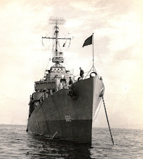 USS Bennion (DD-662) at anchor flying the United States Naval Jack.