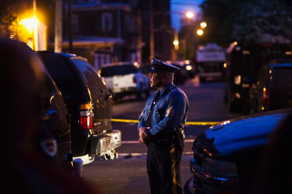 Police surround a South Trenton New Jersey home. Photo by Eduardo Munoz for Reuters.