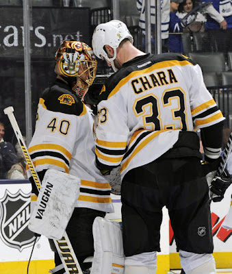 Tuukka Rask and Zdeno Chara celebrate a game 3 win