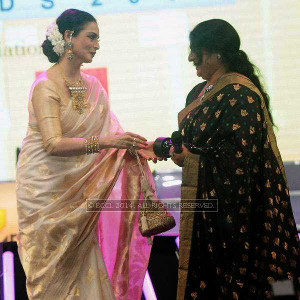 Actress Rekha presents the Lifetime Achievement Award to Jayabharathi during the 61st Idea Filmfare Awards South, held at Jawaharlal Nehru Stadium in Chennai, on July 12, 2014.