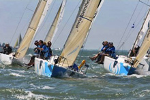 J/80s one-design sailing on Solent, Hamble, England