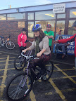 Alison with Sustrans, gingerly trying out their cycling lessons at the Eastham Centre