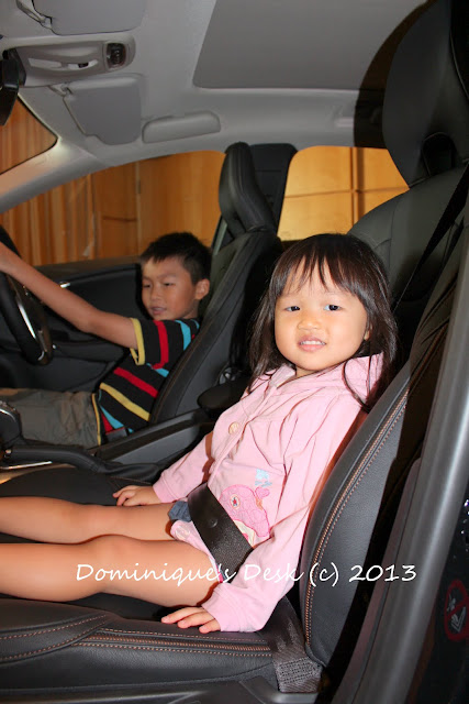 Monkey boy and Tiger girl in the Volvo V40 Cross Country