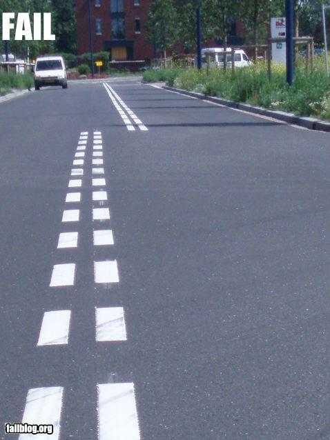 photo of painted road stripes that do not match up