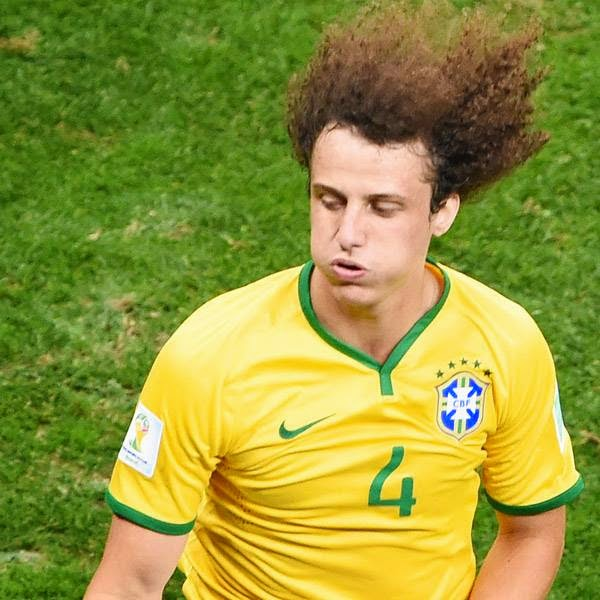 Brazil's defender David Luiz runs during the third place play-off football match between Brazil and Netherlands during the 2014 FIFA World Cup at the National Stadium in Brasilia on July 12, 2014.