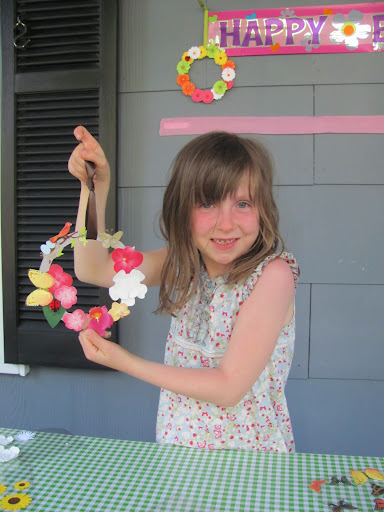 A bird landed on Lily's colorful wreath!