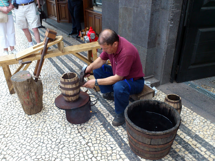 repairing small pipes to put the famous Madeira wine