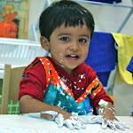 Preschool boy happy in Montessori classroom.