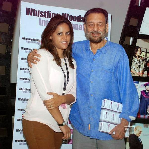 Shekar Kapur poses with a guest during Whistling Woods International Institute's graduation ceremony, held on July 28, 2014.(Pic: Viral Bhayani)