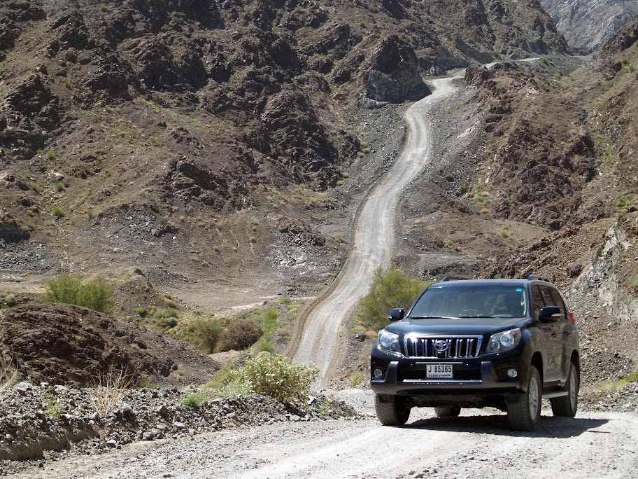A Toyota Prado negotiates the steep but well-maintained track on the way to Wadi Jazira.