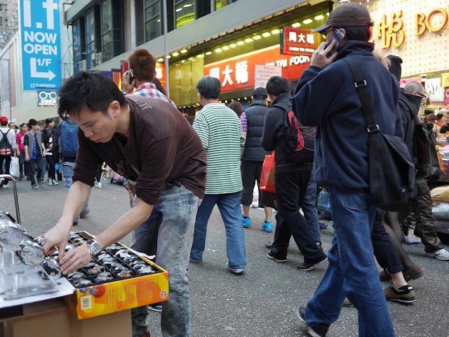 young man selling watches at Sai Yeung Choi Street South