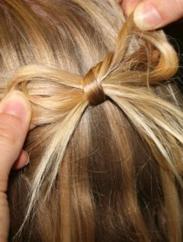Lacinho feito de cabelo