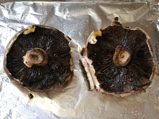 seasoned mushrooms placed on baking sheet lined with tin foil