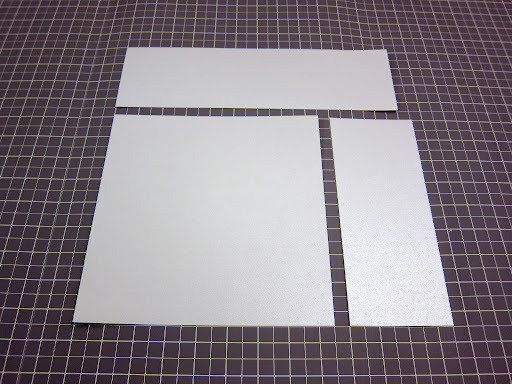 To make a fabulous envelope, I started with a piece of pearlescent cream paper and cut out an 8.5